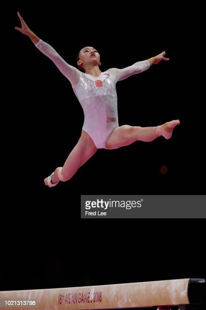 Yile Chen of China in action on the Horizontal Bar during on the Balance Beam during the Artistic Gymnastics of the Women's Team Final at the Jiexpo...