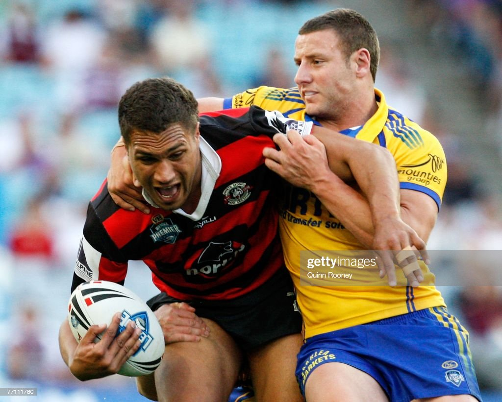 Yileen Gordon of the Bears is tackled by Blake Green of the Eels during the 2007 Premier League Grand Final between the Parramatta Eels and the North Sydney Bears at Telstra Stadium September 30, 2007 in Sydney, Australia.