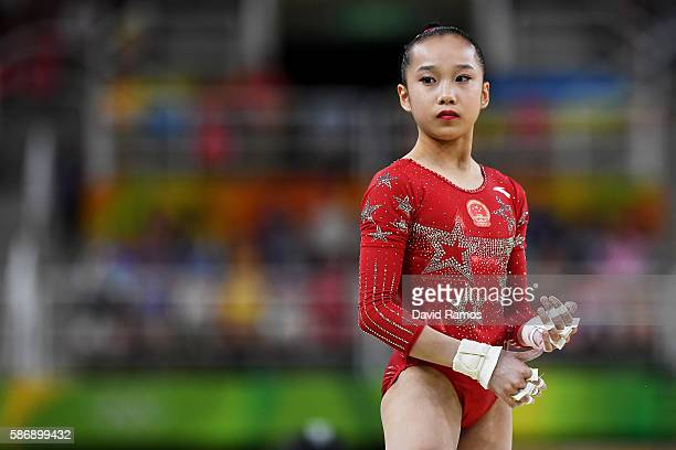 Yilin Fan of China looks on before competing on the uneven bars during Women's qualification for Artistic Gymnastics on Day 2 of the Rio 2016 Olympic...