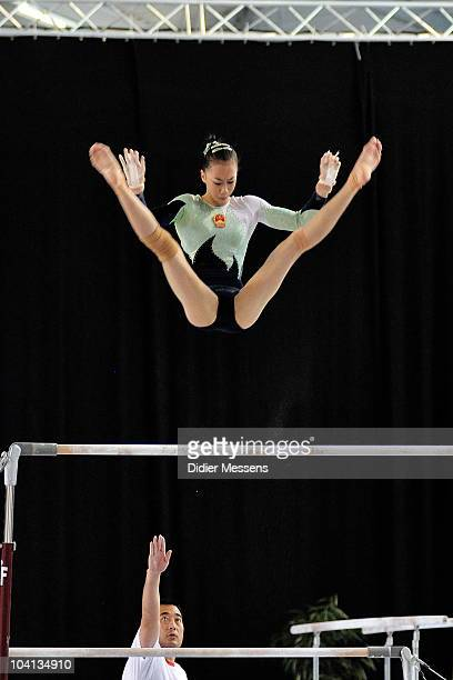 Yilin performs on uneven bars during the qualifications of the Worldcup Gymnastics on September 11 2010 in Gent Belgium