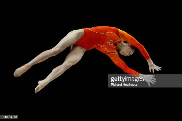 Yilin Yang of China competes in the balance beam event during the second day of the Artistic Gymnastics World Championships 2009 at O2 Arena on...