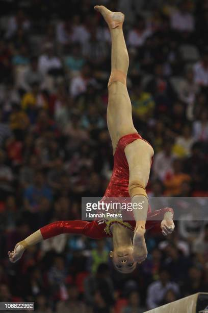 Yilin Yang of China competes in the Women's Team Final beam discipline at the Asian Games Town Gymnasium during day two of the 16th Asian Games...