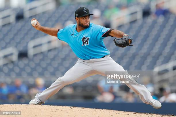 Yimi Garcia of the Miami Marlins delivers a pitch against the Houston Astros in the third inning of a Grapefruit League spring training game at...