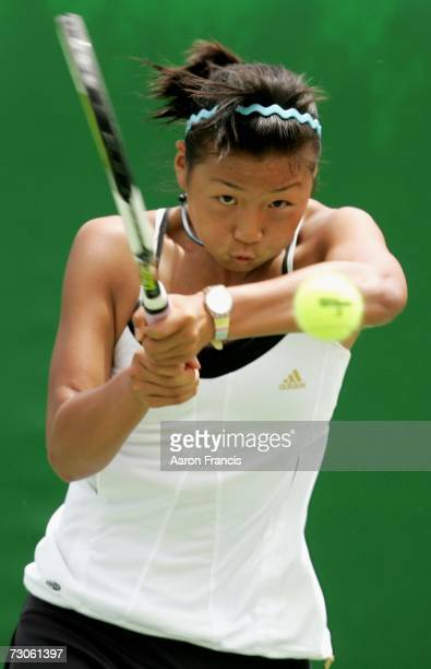 YiMiao Zhou of China plays a backhand during her first round juniors match against Ellen Barry of New Zealand on day eight of the Australian Open...