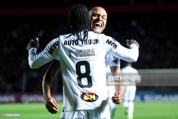 Yimmi Chara of Atletico Mineiro celebrates with teammate Patric after scoring the first goal of his team during the first leg semifinal of Copa...
