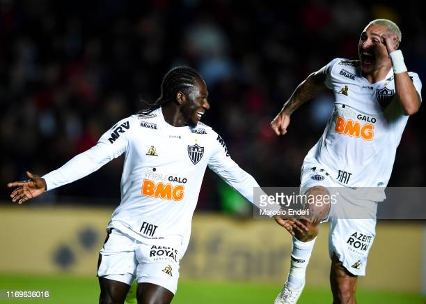 Yimmi Chara of Atletico Mineiro celebrates with teammate Vinicius after scoring the first goal of his team during the first leg semifinal of Copa...