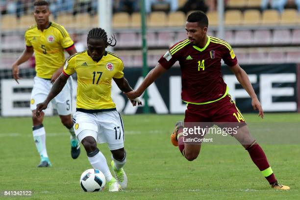 Yimmi Chara of Colombia and Yangel Herrera of Venezuela compete for the ball during a match between Venezuela and Colombia as part of FIFA 2018 World...