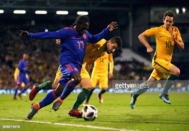 Yimmi Chara of Columbia is challenged by Aziz Behich of Australia during the International friendly between Australia and Colombia at Craven Cottage...