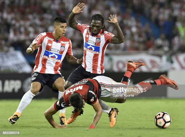 Yimmi Chara of Junior struggles for the ball with Lucas Paqueta of Flamengo during a second leg match between Junior and Flamengo as part of the Copa...