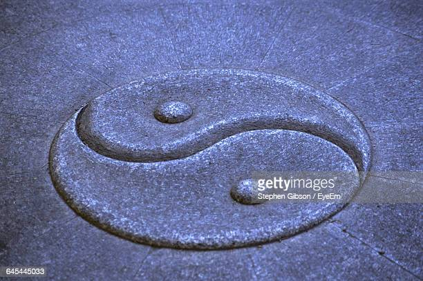 Yin Yang Symbol On Stone Wall