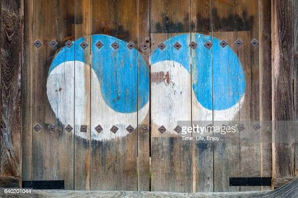 yin yang symbol on the wooden door