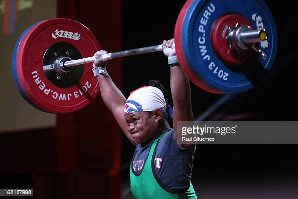 Yineisy Reyes of Dominican Republic A competes in the Women's 58kg during day three of the 2013 Junior Weightlifting World Championship at Maria...