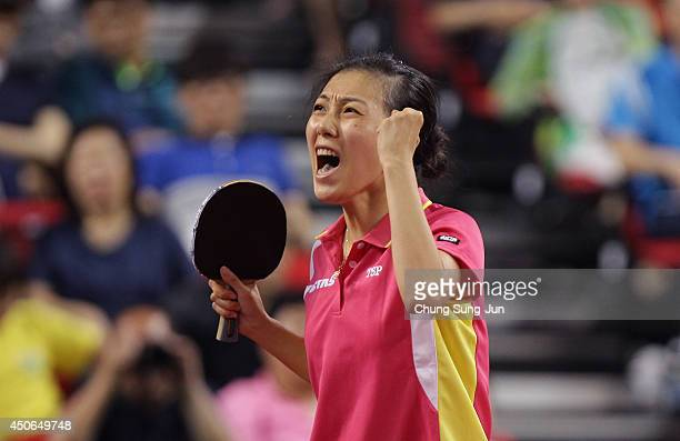 Ying Han of Germany celebrates after win the match against Feng Tianwei of Singapore during day five of 2014 ITTF World Tour Korea Open at on June...
