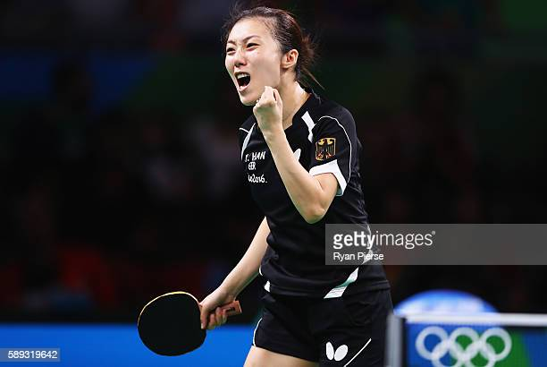 Ying Han of Germany celebrates during the Table Tennis Women's Team Round Quarter Final between Germany and Hong Kong during Day 8 of the Rio 2016...