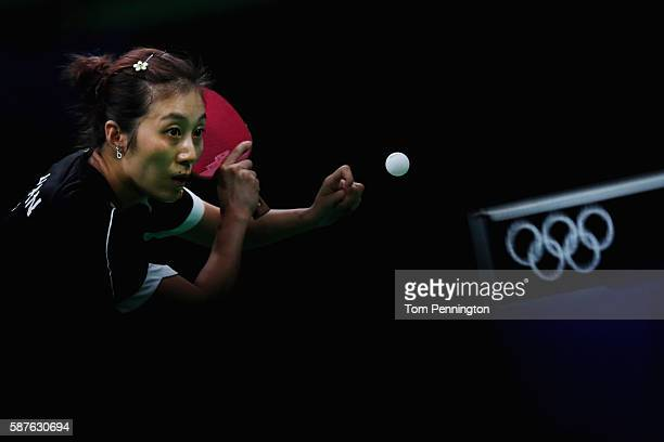 Ying Han of Germany competes against Ning Ding of China during the Women's Singles Quarterfinal 1 Table Tennis on Day 4 of the Rio 2016 Olympic Games...