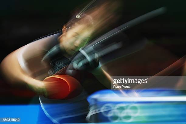 Ying Han of Germany plays a forehand during the Table Tennis Women's Team Round Quarter Final between Germany and Hong Kong during Day 8 of the Rio...