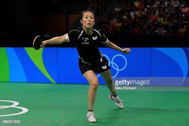 Ying Han of Germany plays a match against Xiaoxia Li of China in the Women's Team Gold Medal Team Match between China and Germany on Day 11 of the...
