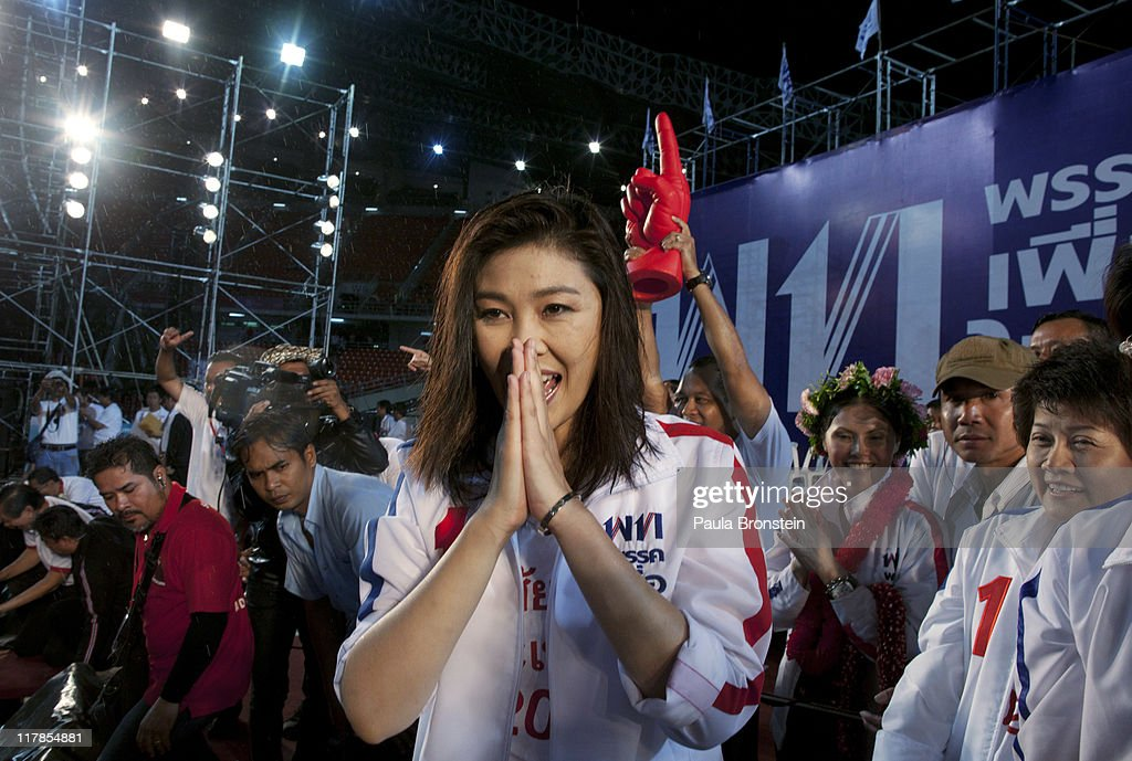 Yingluck Shinawatra greets supporters during a rally on July 1, 2011 in Bangkok, Thailand .Thai's go to the polls on July 3, in a tight race pitting Prime Minister Abhisit Vejjajiva's Democrats against the red shirt movement supported Yingluck Shinawatra, the younger sister of fugitive former prime minister Thaksin Shinawatra, who was ousted in a 2006 coup. This is Thailand's fourth election in seven years.