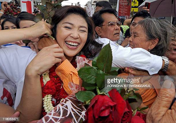 Yingluck Shinawatra sister of fugitive former Thai prime minister Thaksin Shinawatra and candidate for the Puea Thai Party receives hugs from...
