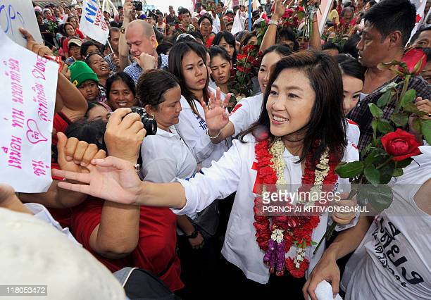 Yingluck Shinawatra sister of fugitive former Thai prime minister Thaksin Shinawatra and candidate for the Puea Thai Party meets supporters as she...
