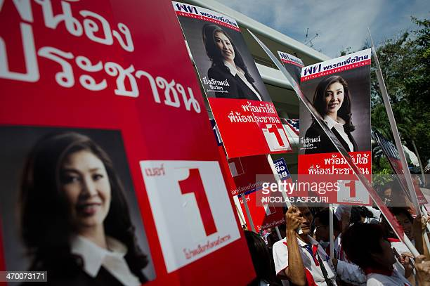 Yingluck Shinawatra sister of fugitive Thai exprime minister Thaksin Shinawatra supporters gather with billboards after her registration as the Puea...
