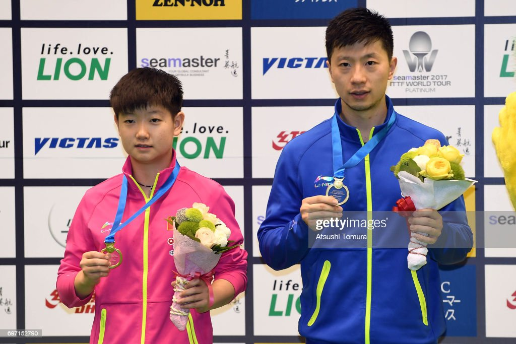 Yingsha Sun (R) and Long Ma of China (L) pose with their gold medals after winning the 2017 ITTF World Tour Platinum LION Japan Open at Tokyo Metropolitan Gymnasium on June 18, 2017 in Tokyo, Japan.