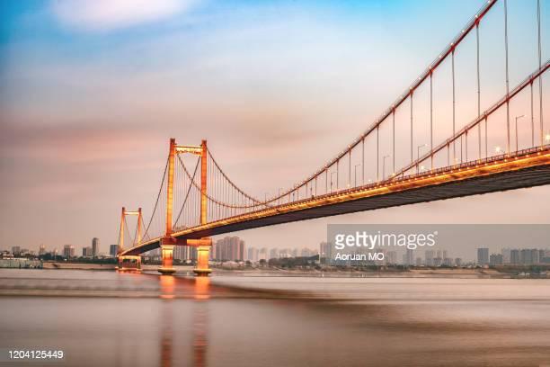yingwuzhou yangtze river bridge - wuhan city stock pictures, royalty-free photos & images