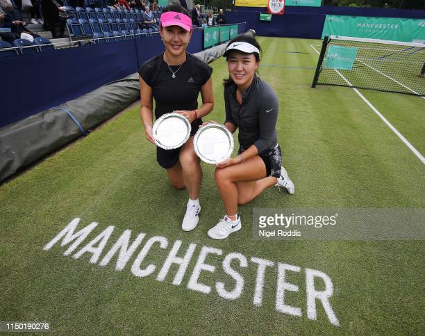 YingYing Duan of China and Lin Zhu of China pose for pictures after winning the Doubles Final of the Manchester Trophy between Robin Anderson...