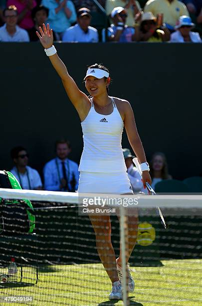 YingYing Duan of China celebrates winning her Ladies Singles first round match against Eugenie Bouchard of Canada during day two of the Wimbledon...
