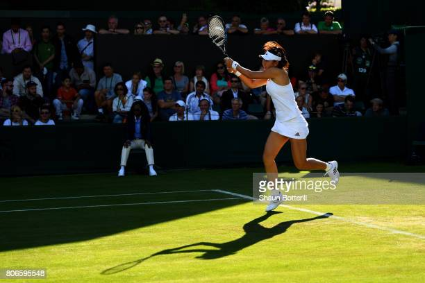 YingYing Duan of China plays a backhand during the Ladies Singles first round match against Ana Bogdan of Romania on day one of the Wimbledon Lawn...