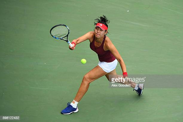 YingYing Duan of China returns a shot to Naomi Osaka of Japan during her second round Women's Singles match on Day Three of the 2016 US Open at the...