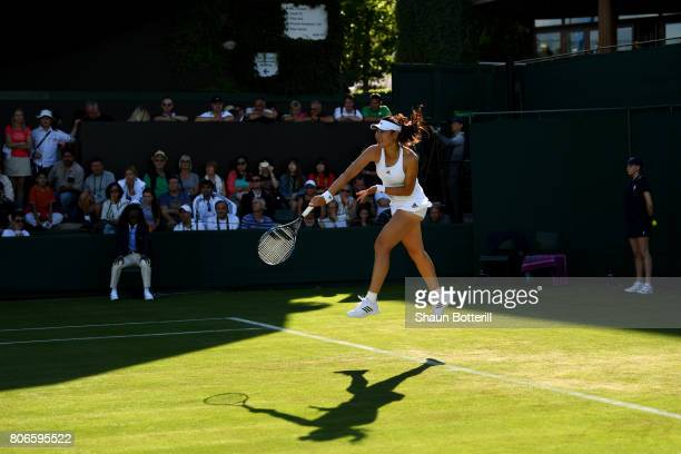 YingYing Duan of China serves during the Ladies Singles first round match against Ana Bogdan of Romania on day one of the Wimbledon Lawn Tennis...