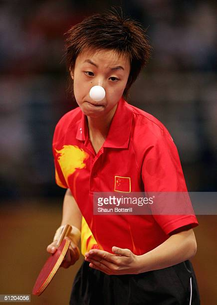 Yining Zhang of China in action in the women's singles table tennis gold medal match on August 22, 2004 during the Athens 2004 Summer Olympic Games...