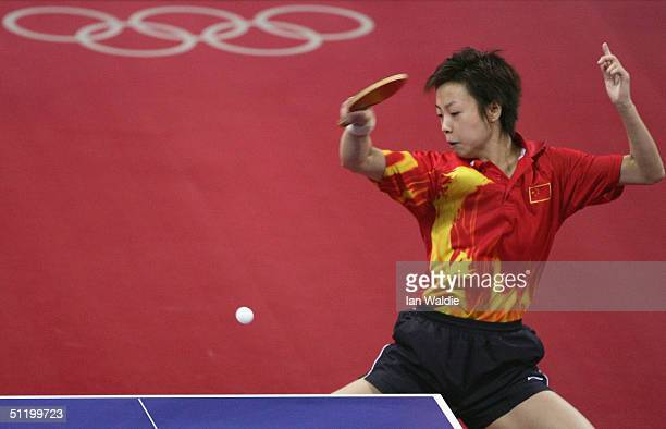 Yining Zhang of China plays a return to Kyung Ah Kim of Korea during the women's singles table tennis semifinal match on August 21, 2004 during the...