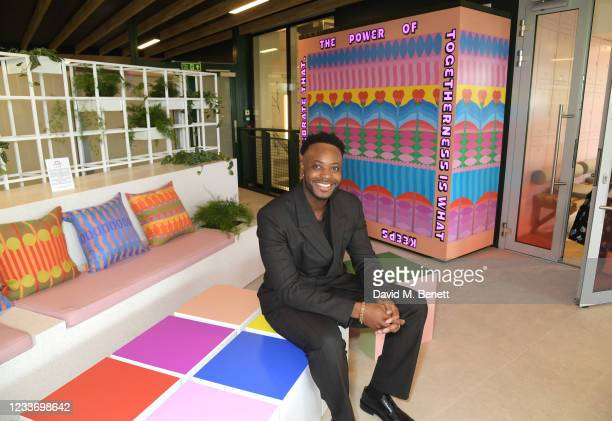 Yinka Ilori poses in evian's VIP suite, certified as carbon neutral by The Carbon Trust, during day one of The Championships, Wimbledon 2021 on June...