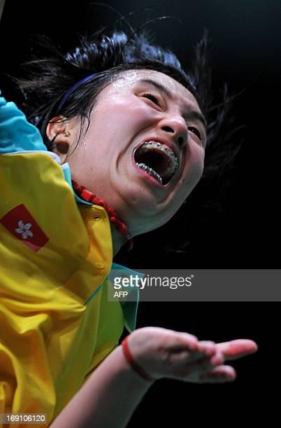 Yip Pui Yin of Hong Kong jumps for a smash against Sung Ji Hyun of South Korea during their match at the 2013 Sudirman Cup world mixed team badminton...