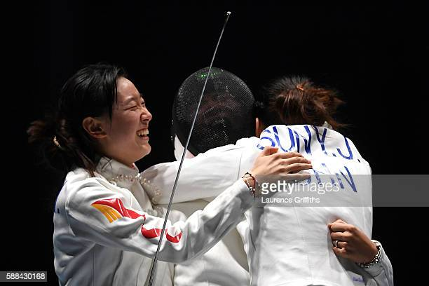 Yiwen Sun Anqi Xu and Yujie Sun of China celebrate after defeating Estonia in a Women's Epee Team Semifinal bout on Day 6 of the 2016 Rio Olympics at...