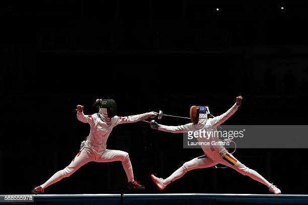 Yiwen Sun of China competes against Simona Gherman of Romania during the Women's Epee Team Gold Medal Match bout on Day 6 of the 2016 Rio Olympics at...