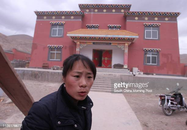 """Yixi Cuomao, offspring of Dongcang family talks to reporter in front of the new family museum to home the Dongcang Da Zang Jing known as """"the..."""