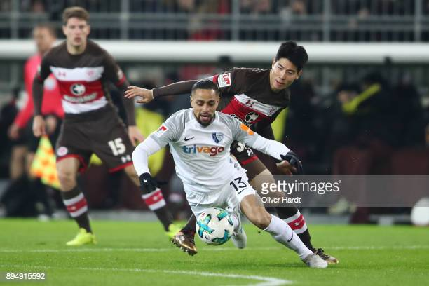 Yiyoung Park of Pauli and Sidney Sam of Bochum compete for the ball during the Second Bundesliga match between FC St Pauli and VfL Bochum 1848 at...