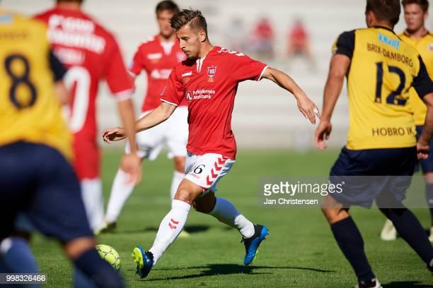 Ylber Ramadani of Vejle Boldklub compete for the ball during the Danish Superliga match between Vejle Boldklub and Hobro IK at Vejle Stadion on July...
