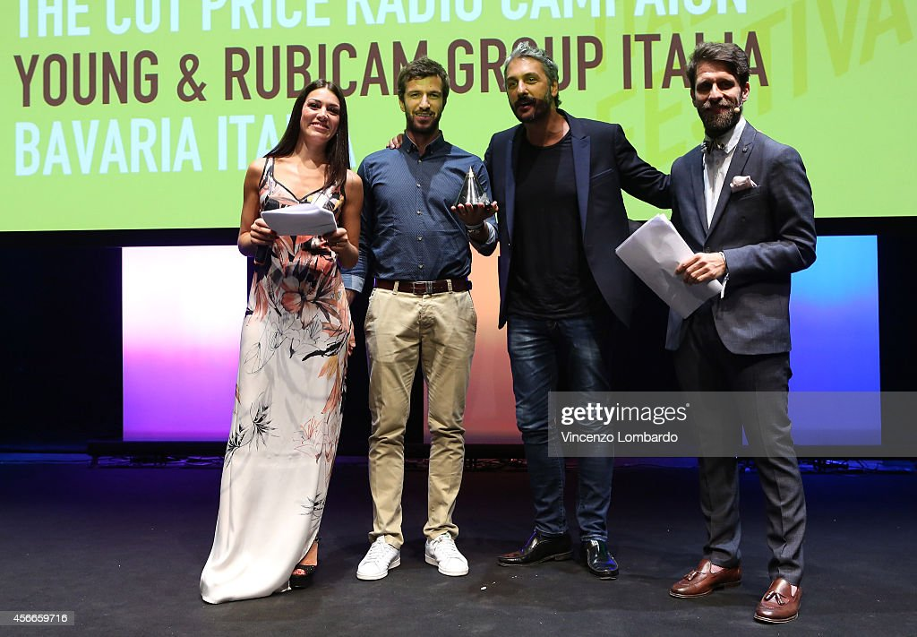 Ylenia and Cristiano Seganfreddo congratulate guest as they attend the Prize Giving Ceremony 2014 ADCI Awards at IF! Italians Festival at Franco Parenti Theater on October 4, 2014 in Milan, Italy.