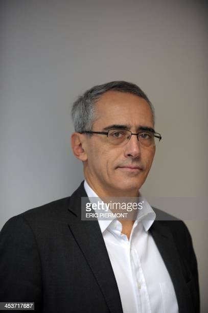 Ymagis CEO and Chairman of the Board of Directors Jean Mizrahi poses on December 3, 2013 at the company headquarters in Montrouge, near Paris. Ymagis...