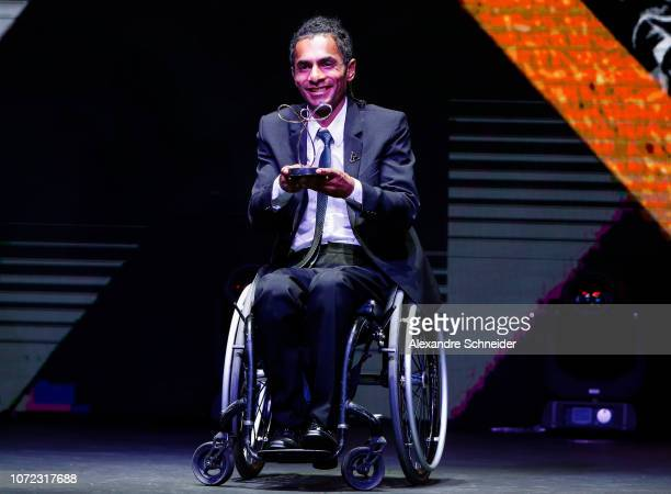 Ymanitu Geon paralympic athlete poses for photo after winning the best tennis athlete during the Brazil Paralympics Awards Ceremony 2018 at...