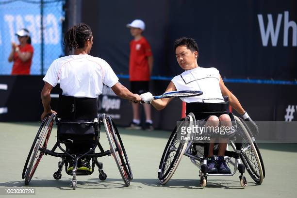 Ymanitu Silva of Brazil and Shota Kawano of Japan celebrate winning a point during the final of the men's quad doubles against Bryan Barten and David...