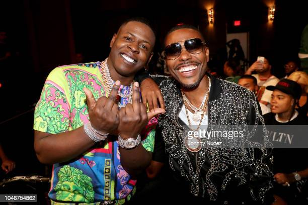 Yo Gotti and Lil Duval attend the BET Hip Hop Awards 2018 at Fillmore Miami Beach on October 6, 2018 in Miami Beach, Florida.