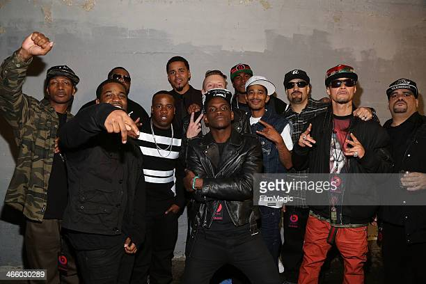 Yo Gotti J Cole Macklemore BReal and others pose with Bone ThugsNHarmony at the Beats Music Launch Party at Belasco Theatre on January 24 2014 in Los...