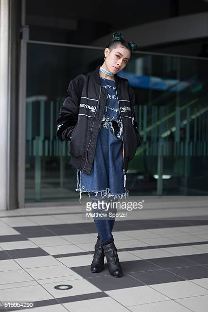Yo H attends the Anne Sofie Madsen show during Tokyo Fashion Week wearing MYOB jacket and Forever 21 dress on March 16 2016 in Tokyo Japan
