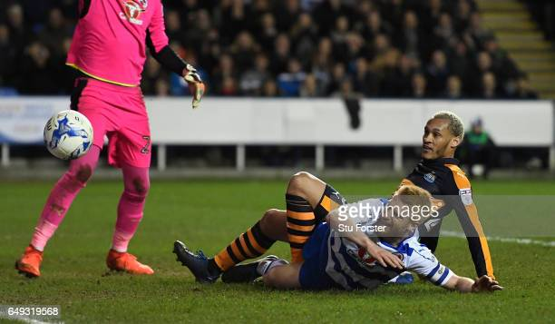 Yoan Gouffran and Paul McShane compete for the ball during the Sky Bet Championship match between Reading and Newcastle United at Madejski Stadium on...