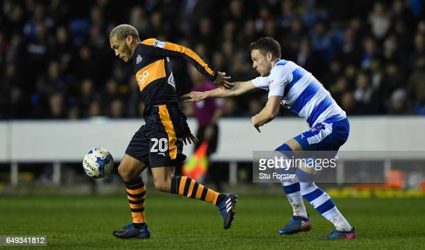 Yoan Gouffran holds off the challenge of Chris Gunter of Reading during the Sky Bet Championship match between Reading and Newcastle United at...